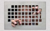 man trapped behind wall grate graphic xl